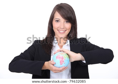 woman holding world globe in her hands - stock photo