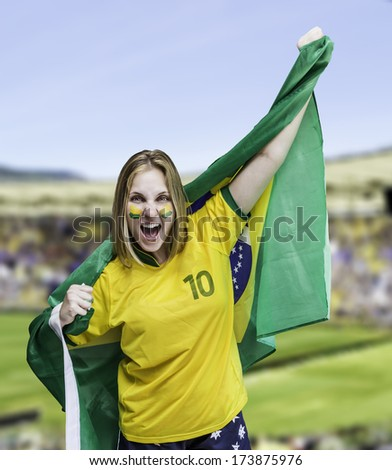 Woman holds a flag of brazil on the Stadium - stock photo