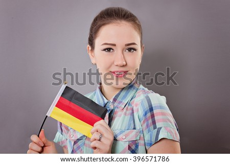 Woman holds german flag - stock photo