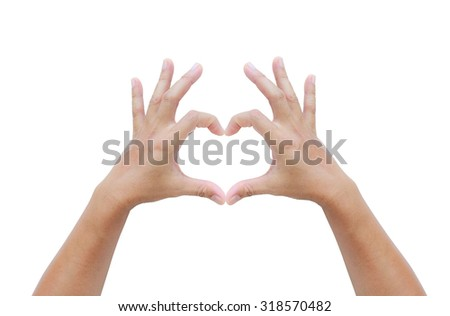 Woman holds hands in the shape of a heart on white - stock photo