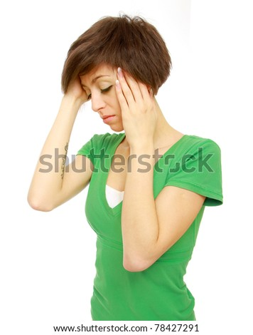 Woman holds head with pain - stock photo