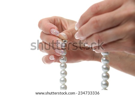 Woman holds in hands of pearl necklaces  - stock photo