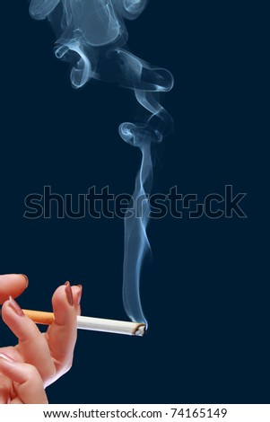 Woman holds in her hand cigarette which produce smoke - stock photo