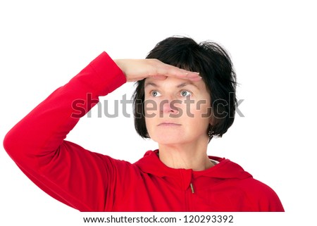 Woman holds open hand to his forehead and looks into the distance