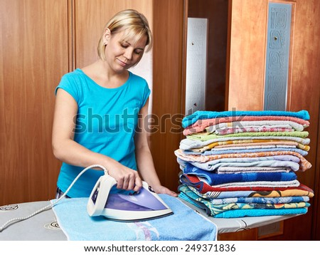 Woman housewife from the ironing board - stock photo