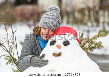 woman hugged a snowman