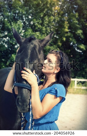 woman hugging a horse - stock photo