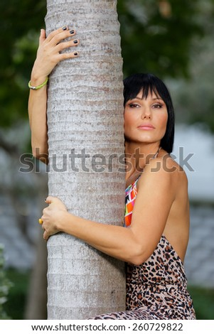 Woman hugging a tree bark - stock photo