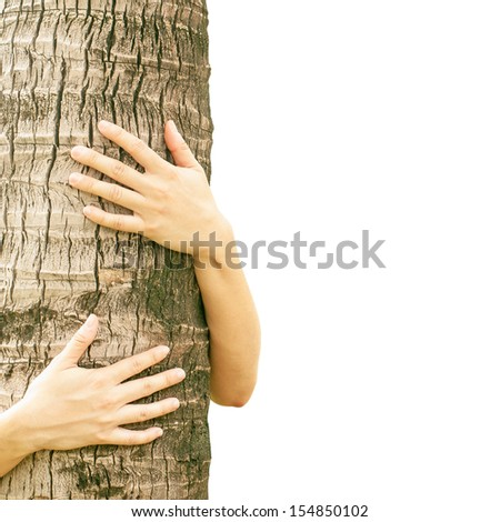 Woman hugging a tree with white background.