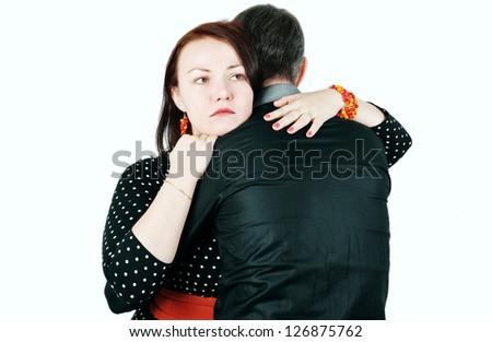 Woman hugging and comforting man - stock photo