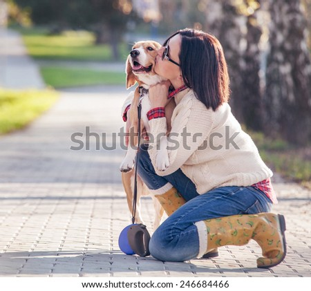 Woman hugs her favorite pet - stock photo