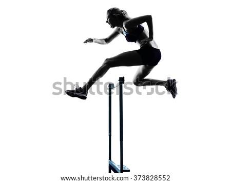 woman hurdlers  hurdling  silhouette - stock photo