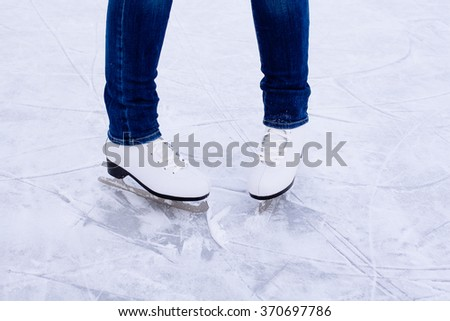 Woman ice skating. winter outdoors on ice rink. ice and legs - stock photo