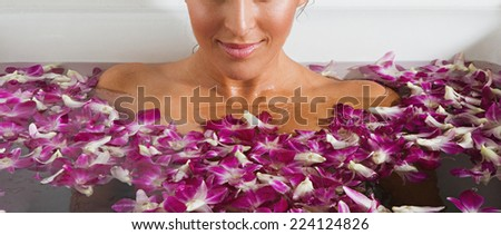 woman in a bathtub and a flower  - stock photo