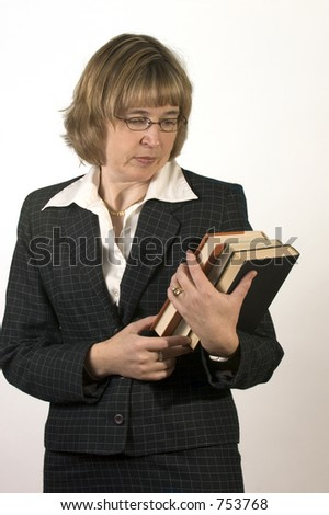 Woman In A Business Suit Carrying Some Books - stock photo