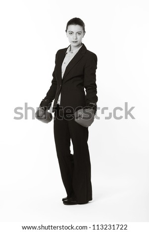 woman in a business suit wearing boxing gloves