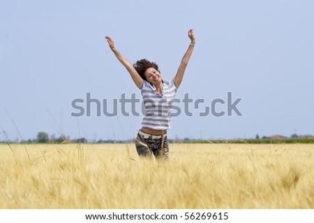 Woman in a cornfield. - stock photo