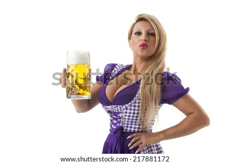 woman in a dirndl with a beer  - stock photo
