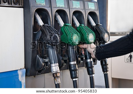 woman in a fuel station - stock photo