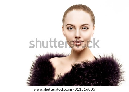 Woman in a fur coat. Young beautiful model in winter outerwear. Stylish luxury girl on a white background - stock photo