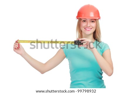 Woman in a helmet with tape measure posing against white background