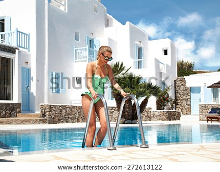 Woman in a hotels pool - stock photo