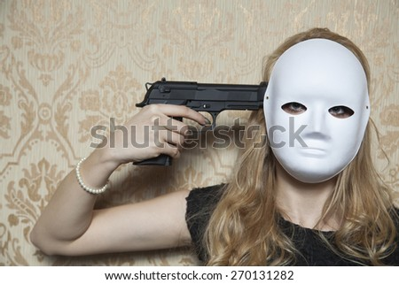 woman in a mask wants to commit suicide - stock photo