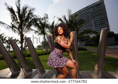 Woman in a Miami Beach scene stock photo - stock photo