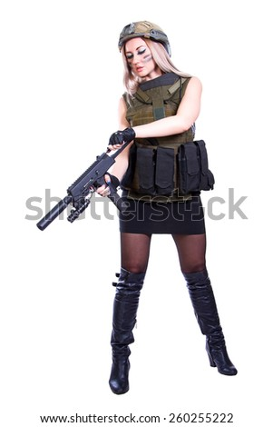 Woman in a military camouflage reloading the smg isolated over white background - stock photo