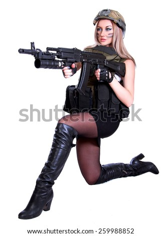 Woman in a military camouflage sitting with the assault rifle isolated over white background - stock photo