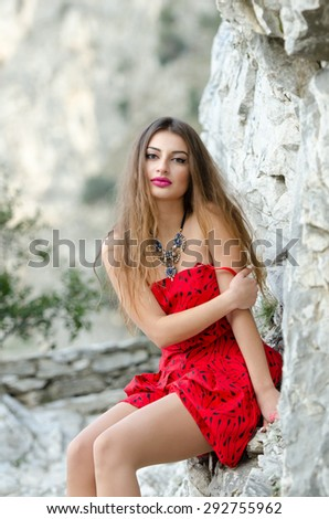 Woman in a red dress like a little red riding hood - stock photo