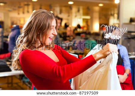 Woman in a shopping mall downtown looking for clothes