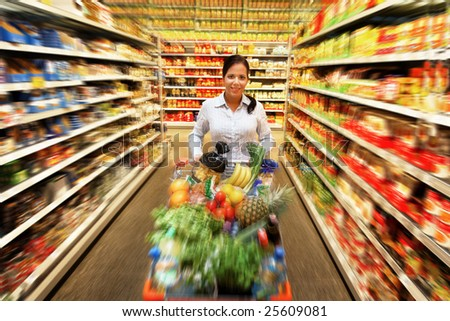 Woman in a supermarket to buy fresh food - stock photo