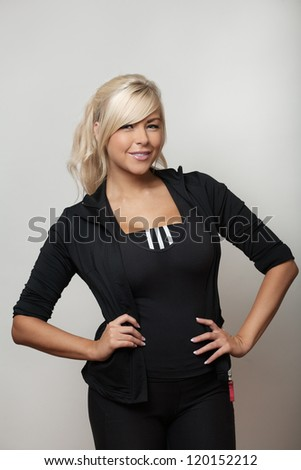 woman in a tracksuit ready to go down the gym for her work out and keep fit - stock photo