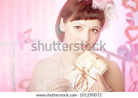 Woman in a vintage dress with old letters in her hand. - stock photo