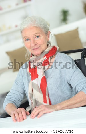 Woman in a wheelchair - stock photo