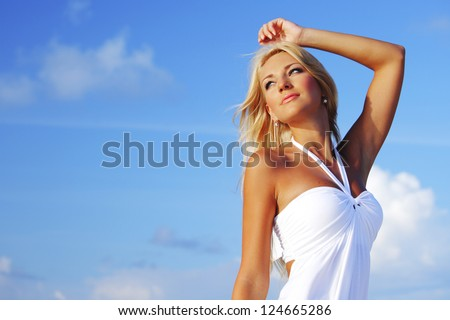 woman in a white dress on the ocean coast - stock photo