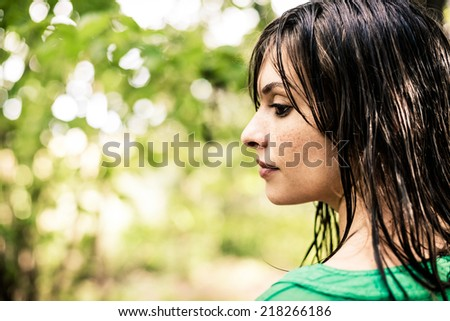 Woman in a wood. Wet after a rainfall. - stock photo