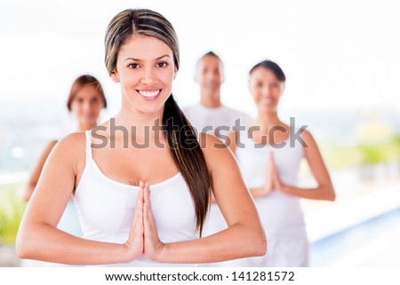 Woman in a yoga class with a group of people - stock photo