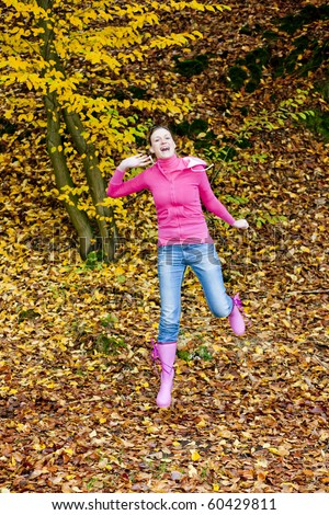 woman in autumnal nature - stock photo