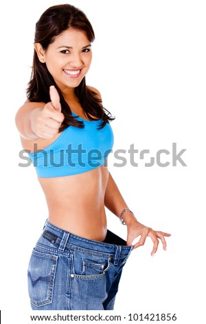 Woman in baggy pants with thumbs up - isolated over a white background - stock photo