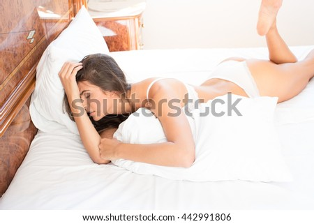 Woman in bed looking sad