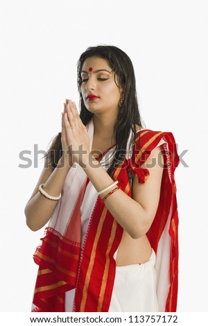 Woman in Bengali sari in prayer position