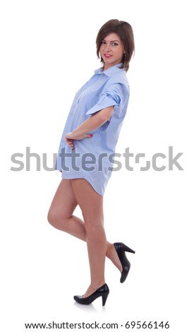 woman in big man shirt over white background - stock photo