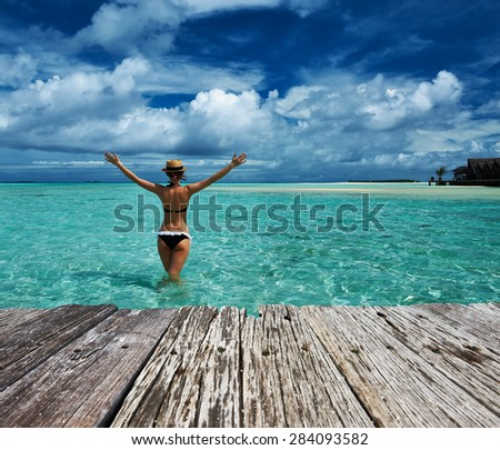 Woman in bikini at tropical beach - stock photo