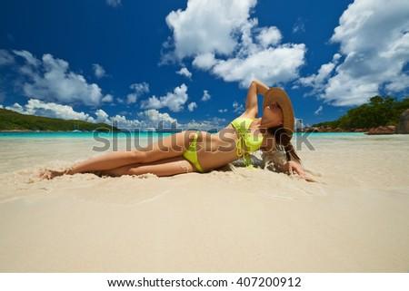 Woman in bikini at tropical beach at Seychelles - stock photo