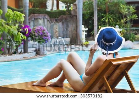 woman in bikini enjoying sunbath in luxury hotel - stock photo