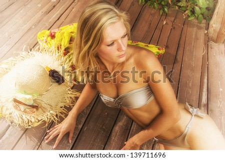 Woman in bikini on the deck - stock photo