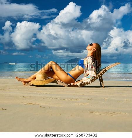 Woman in bikini on tropical beach at Seychelles - stock photo