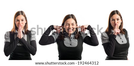 woman in black clothes pleading, covering her ears, and doing silence gesture - stock photo